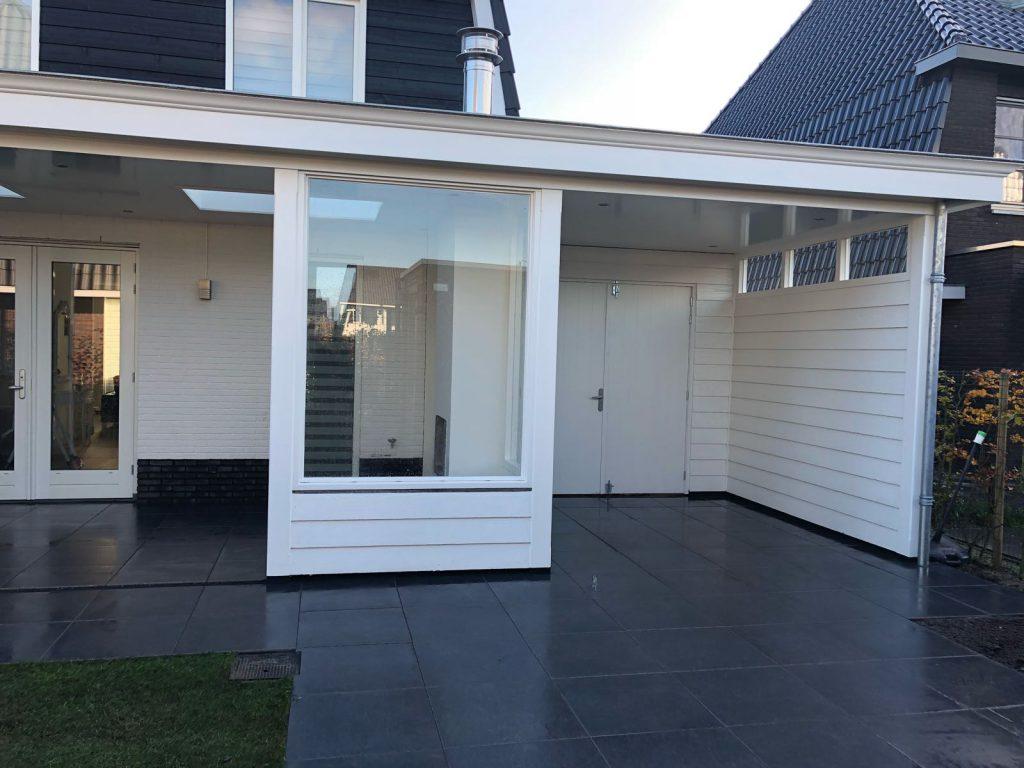 Moderne veranda met haard te Blaricum-001