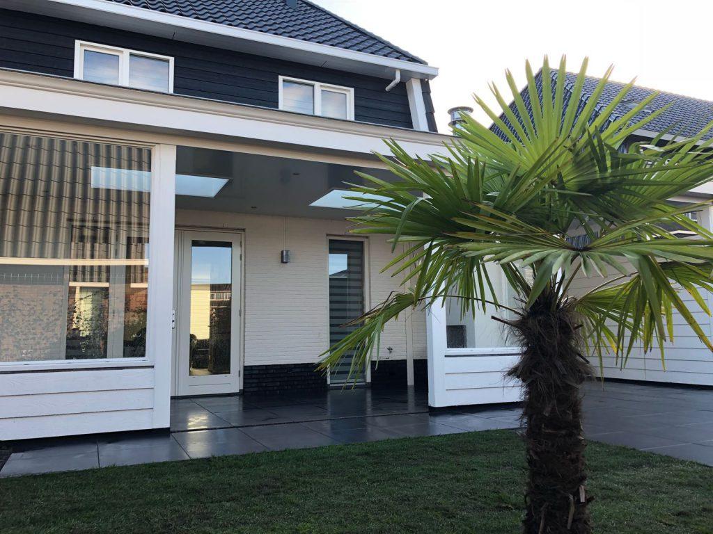 Moderne veranda met haard te Blaricum-006